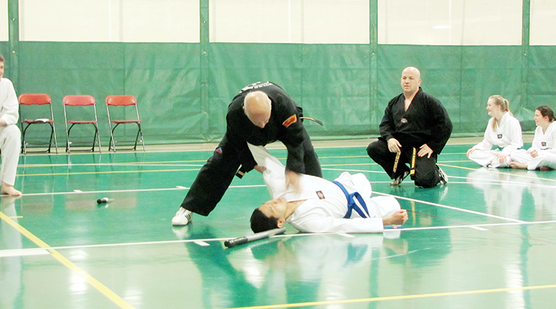 Antonio Eppolito, 74, recently received his fourth-degree black belt at The Le Moyne College Tae Kwon Do Club. Here he demonstrates his skill before receiving his belt and becoming a master.