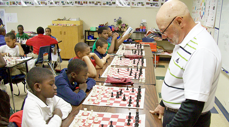 Bob Nasiff, 73, a certified chess master with the U.S. Chess Federation, playing chess with students at Southside Academy in Syracuse.