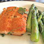 Sauteed salmon with herb butter and asparagus.