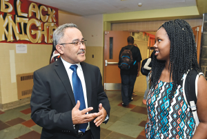 Interim superintendent Alicea talking to a high school student in Syracuse.