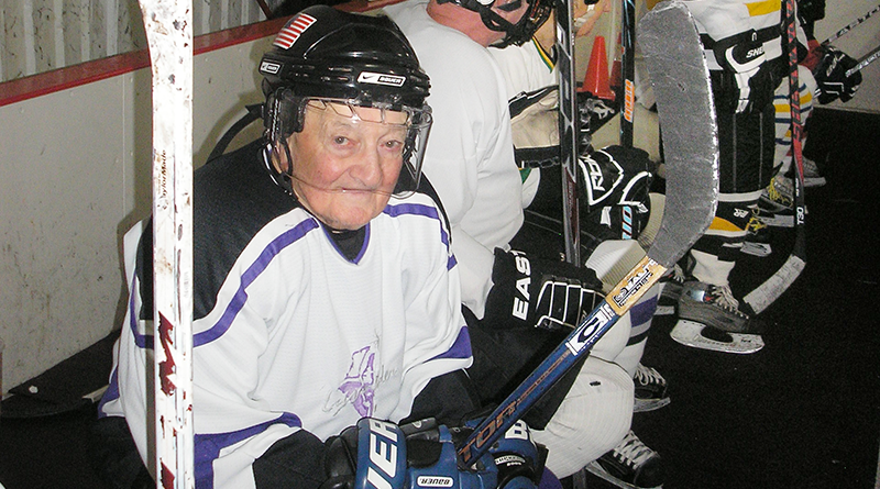 "Members of the Gray Wolves Senior Hockey club waiting to play at Cicero Twin Rinks in Cicero. Shown on the left is Dick ""D.D."" Lynch, an 89-year-old player."
