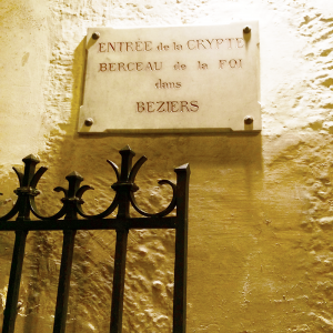 This sign so intrigued the Reeds, they braved an underground passage lit only by their cellphones. The sign reads: Entrance of the crypt. Cradle of faith in Beziers.