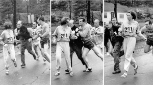 "Kathrine Switzer making the news during the Boston Marathon April 19, 1967. The original caption in the Boston Herald read,  ""Who says chivalry is dead? When a girl listed as 'K. Switzer from Syracuse' found herself about to be thrown out of normally all-male Boston Marathon today, husky companion Thomas Miller of Syracuse threw a block that tossed the race official out of the running instead. The photo of this confrontation flashed around the globe and became one of Time-Life's ""100 Photos that Changed the World."" Photos courtesy of the Boston Herald."
