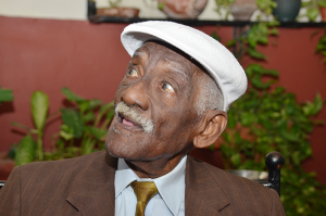 One of the most popular, yet aged, Cuban Bar and Restaurant Musician, Manocotta. Still performing at age 75.