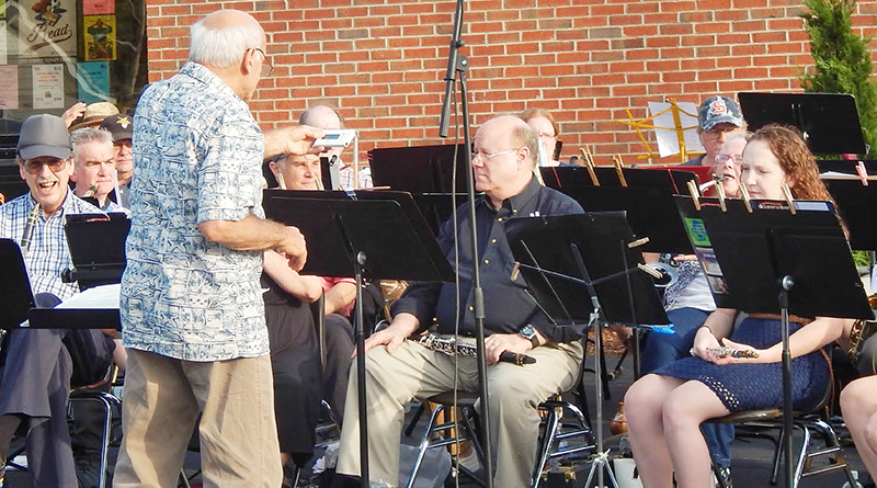 Members of the Lyncourt Community Band performing last year in front of the East Syracuse Free Library in East Syracuse. A diverse membership performs throughout the summer.