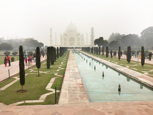 Fog or smoke hangs over much of india, including in the Taj Mahal area this is the beautiful Taj Mahal in India but shrouded in smog from pollution in the air.