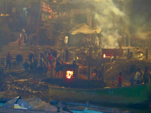 Evening cremations in the Ganges River in Varanasi, one of the oldest cities in the world. It is also where families bring their departed loved ones to be cremated as the city is considered sacred.