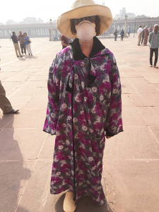 "The author in burka at Old Delhi Jama Masjid mosque. ""Within a week of our group's arrival, the majority of people had difficulty breathing even while wearing masks,"" says Pinsky."