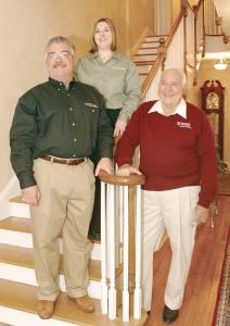 Sal Sciuga, Sr. (right), founder of Sciuga Custom Builders, his son, Sal, Jr., president of the company, and Sal's daughter, Dana Sciuga Bakowski, customer selections coordinator.