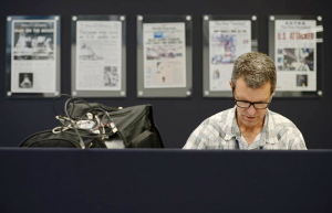 Sean Kirst writing one of his columns at The Post Standard in Syracuse. Kirst wrote his last column for the paper in October 2015. He now writes for The Buffalo News. Photo courtesy of Michelle Gabel.