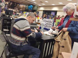 "Kirst at one of his book signing at Barnes & Noble in DeWitt. He has written three books during his career. The most recent — ""The Soul of Central New York"" — was released late last year. Photo courtesy of Mike Roy."