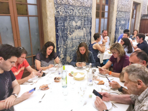 Some members of the Druger family communicating before dinner in a restaurant in Portugal. Photo courtesy of Lindsey Jamieson.