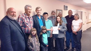 Members of the Fulton Amateur Radio Club at the presentation of the Thomas Cantine Memorial Scholarship at its May meeting. From left are Redd Swindells, Bob LaMay, Dave Granoff, Daniel Grant (scholarship winner) Tom Grant, Pam Cantine, Fred Koch, Henry Laura and Chris Lighthife, Also in front are Pam & Tom Cantine's twin girls, Joslyn and Gracyn.