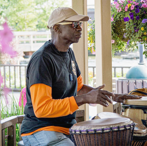 John Heard has been playing African-style percussion for 30 years with such artists as jazz saxophonist Jesse Collins, and taught an after-school program for the Syracuse City School District.