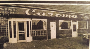Facada of Caroma at 402 Lodi St. in Syracuse.The building is now the site of the site of the Syracuse Cultural Workers.