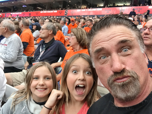 Daniel Baldwin with daughters Finley and Avis during the Sept. 9 game between Syracuse and Middle Tennessee State. Photo provided.