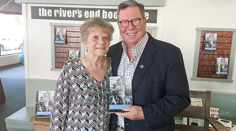 "Former City of Oswego Mayor John T. Sullivan, right, is congratulated by Jeanne Byrne, secretary to City of Oswego Mayor William ""Billy Barlow,"" at a recent booksigning at the river's end bookstore in Oswego."