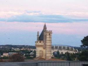 """This """"castle"""" at sunset was the view from Michele's hospital room. We think it was a former monastery or convent, now being used as a school. The round structure behind it and to the right is the rugby stadium."""