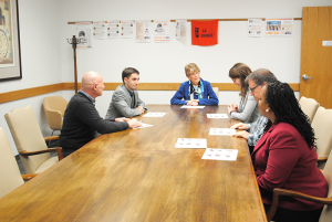 Eaton in a meeting with members of her staff in Syracuse. From left, Vince Spicola, Tyler Greco, Nan Eaton, Emily Winiecki, Tim Ferlito, and Tatiana Parker.