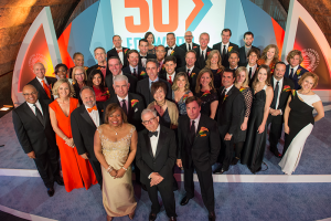 Lorraine Branham and Donald Newhouse with alumni honorees at the Newhouse School's 50th anniversary gala in New York City, October 2015, when 50 alumni were honored. Directly behind them, from left, are Mike Tirico '88, who emceed the event, and special honorees Tonia O'Connor '91, Larry Kramer '72, Rob Light '78, Kitty Lun G '80, and Bob Costas '74.