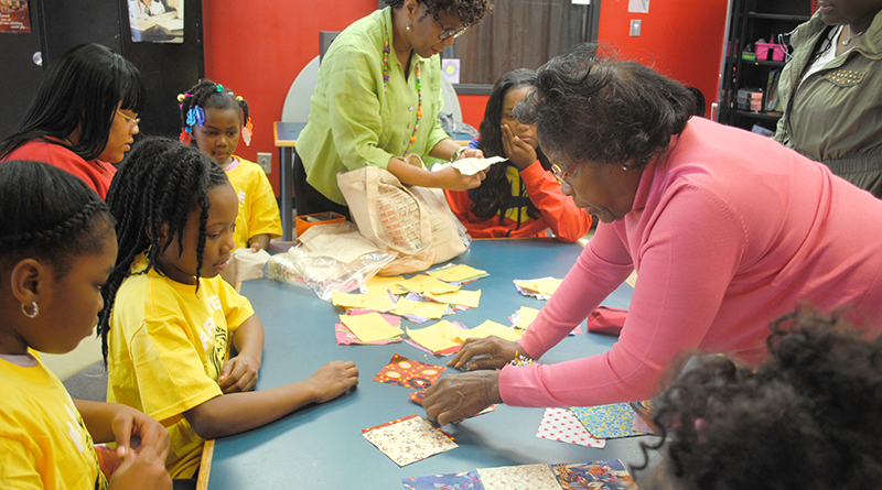 "Dorothy (""Dottie"") White teaching kids at Southwest Community Center in Syracuse the basics of quilting."