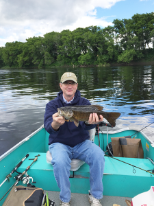 Grant Reeher is an avid outdoorsman. He is shown holding a smallmouth bass on the Connecticut River.