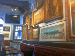 The walls of Bar Les Templiers are lined with artwork by famous and lesser-known artists, who paid their bar tab with paintings.