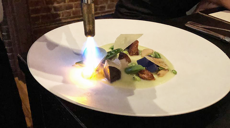 Spring Pea Torch: The spring pea and parmesan plate gets special treatment before being served.