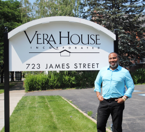 Kilpatrick poses outside the offices of Vera House on James Street in Syracuse. He works fulltime at the nonprofit as the men's outreach coordinator.