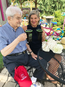 Ed Balian with his daughter Barb Rinella from DeWitt  enjoy some tea in the Sensory and Healing Garden at Sollecito Landscaping Nursery in Syracuse.