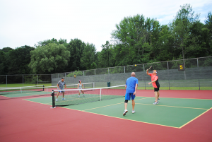 "Elton Garvin and his wife Kate Garvin against (left) playing pickleball recently at Lysander Town Park against Jan Cary (orange shirt) and Greg  O'Neill. ""It's like playing an instrument. You don't get better unless you practice,"" says Elton Garvin about pickleball."