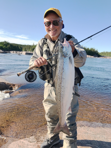 Sollecito holding an Atlantic salmon during his trip to northern Quebec earlier this summer. Photo provided.