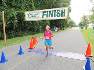Rosemarie Nelson running in the Willow Bay 5K in Liverpool in 2017. At 63, she has run hundreds of races. She's been named the Road Runners Club of America State Half-Marathon Female Senior Grand Master Champion.