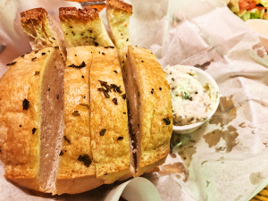 The garlic and rosemary-topped bread with garlic and chive butter.