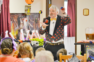 David Jackman in a lighter moment as he juggles for an audience. When Jackman was a child he saw a lecture on juggling, went home and taught himself how to juggle on the spot.