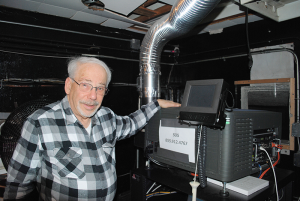 Nat Tobin shown next to the digital projection system. Moving over to the new system was a big change for the theater, but one that needed to be made in order to keep the doors open, Tobin said.