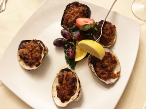 The clams casino, a common appetizer, packs a lot of flavor in a half-shell.