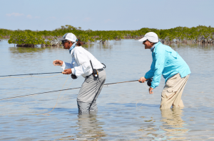 Jim Sollecito, right, pursuing bonefish in the shallow waters of Bay of Pigs in Cuba. Photo courtesy of Larry Beneventi.