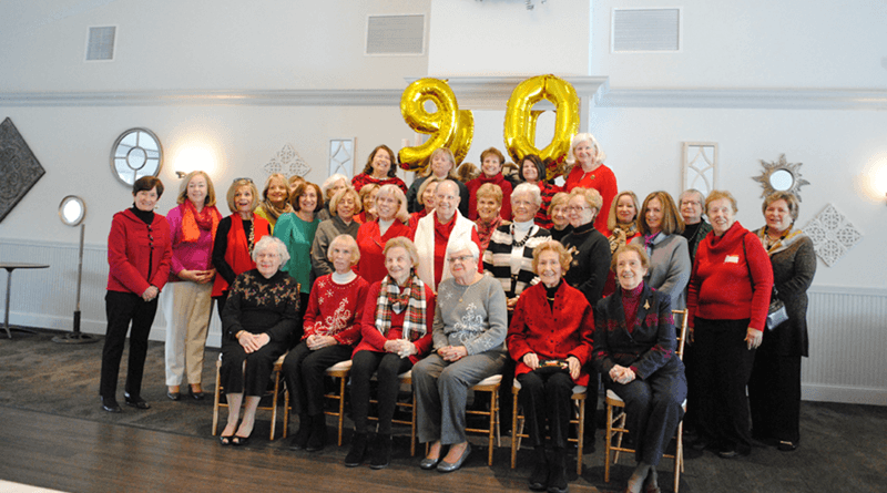 Members of the Tuesday Book Club pose during the group's 90th anniversary celebration at Traditions at the Links in East Syracuse.