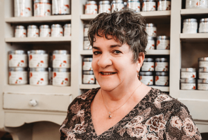 Nancy Pfeiffer at Tipplers Teacup in Manlius. She sells furniture she repurposes and is also a vendor of Country Chic paint, her favorite line of eco-friendly chalk paint from Canada. Courtesy of Jennifer Reed Photography.