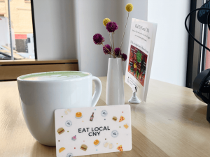 The Eat Local CNY card is one of the way people can save on food. It gives users a $5 discount for every $25 spent at dozens of participating restaurants.