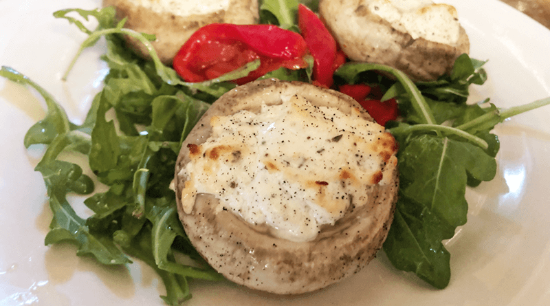 Goat cheese-stuffed mushroom.