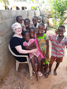 During a visit to Africa, Dawn La Flamm received a crash course in the culture and the idea of poverty as a way of life.  She decided to help the way she could. She raised enough money to build a library in a remote part of Ghana. She is shown with kids who frequently visit the library, Rose Villa Library.