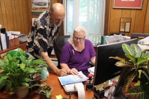 Mayor Platten goes over some paper work with Village Clerk Cynthia Meixner.