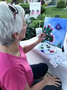 The author's sister, Kathy, likes to add color to her own landscape and canvas.