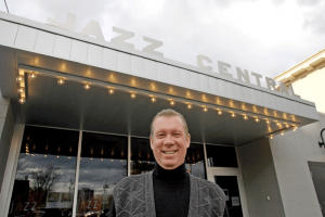 Luttinger in front of CNY Jazz Central on East Washington Street in Syracuse. Below: announcing at NE Jazz & Wine Fest 2006.