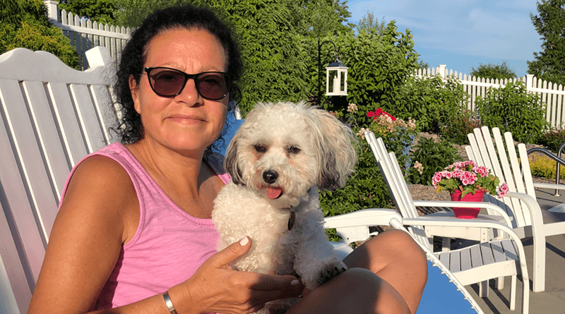 Maryann Roefaro holding her poodle, Millie. She recently published a new book that deals with everything from life, death and families. Roefaro is the CEO of Hematology/Oncology Associates of Central New York.