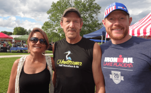 Mike Samoraj (center) with his wife, Michelle, a marathon runner, and his training coach, Toby Heath.