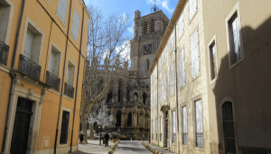 The Cathedral of St. Nazaire and St. Celse, as seen from the streets of Beziers. It was rebuilt after being completely destroyed by fire in 1209. The older, Romanesque tower, is on the right, and the 13th-15th century gothic nave is on the left. Photo By Bill Reed