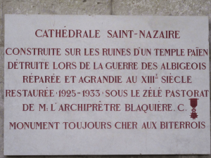 "This plaque tells of the rebuilding of the cathedral from the 13th century onward, and calls the building ""forever dear to all the Bitterois (the name for the residents of the area around Beziers)."" Photo By Bill Reed"